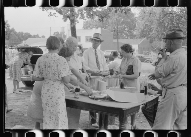 Brunswick stew dinner in front of the tobacco warehouse on opening day of the auctions. Prepared by Parent Teachers Association of Prospect Hill, to raise money for a new gymnasium for the Prospect Hill Consolidated School in Caswell County, North Carolina
