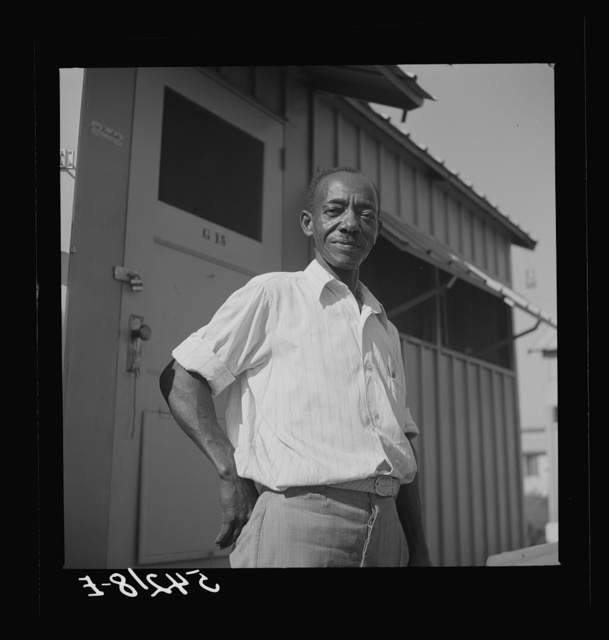 Camp member moving into shelter at Okeechobee migratory labor camp. Belle Glade, Florida