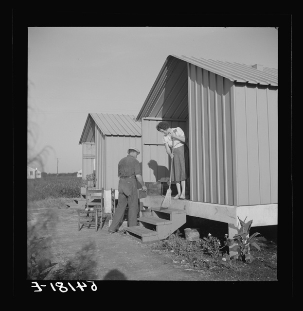 Camp member on porch of her shelter at Osceola migratory labor camp. Belle Glade, Florida