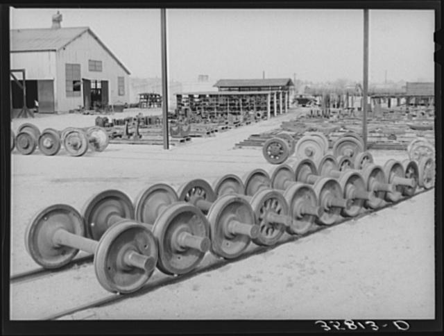 Car wheels and general equipment lot at railroad yard in Big Spring, Texas