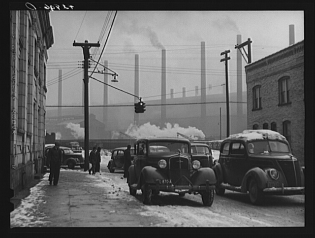 Cars of steelworkers leaving the mill in Midland, Pennsylvania