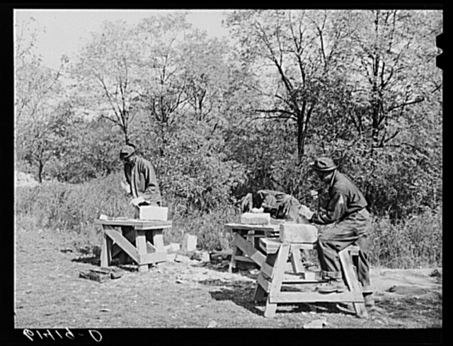CCC (Civilian Conservation Corps) boys chopping stones for use in building charcoal burners at picnic grounds of recreation area. Ross County, Ohio