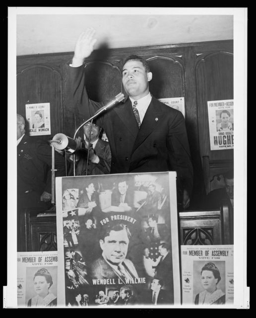 "Champ takes to hustings for Willkie declaring that there is ""no future on relief and the WPA,"" heavyweight champion Joe Louis speaks in behalf of Republican presidential candidate Wendell L. Willkie at a political rally in New York City's Harlem district Oct. 31"