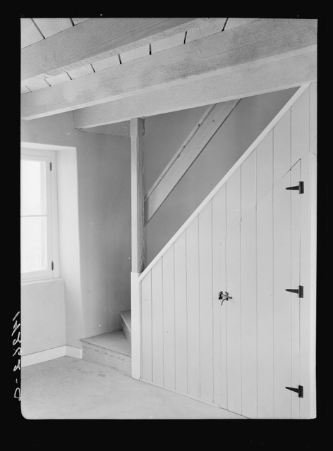 Chandler, Arizona. Stairs and storage in one of the houses at Chandler Farms, a Farm Security Administration part-time farming and cooperative project in Maricopa County