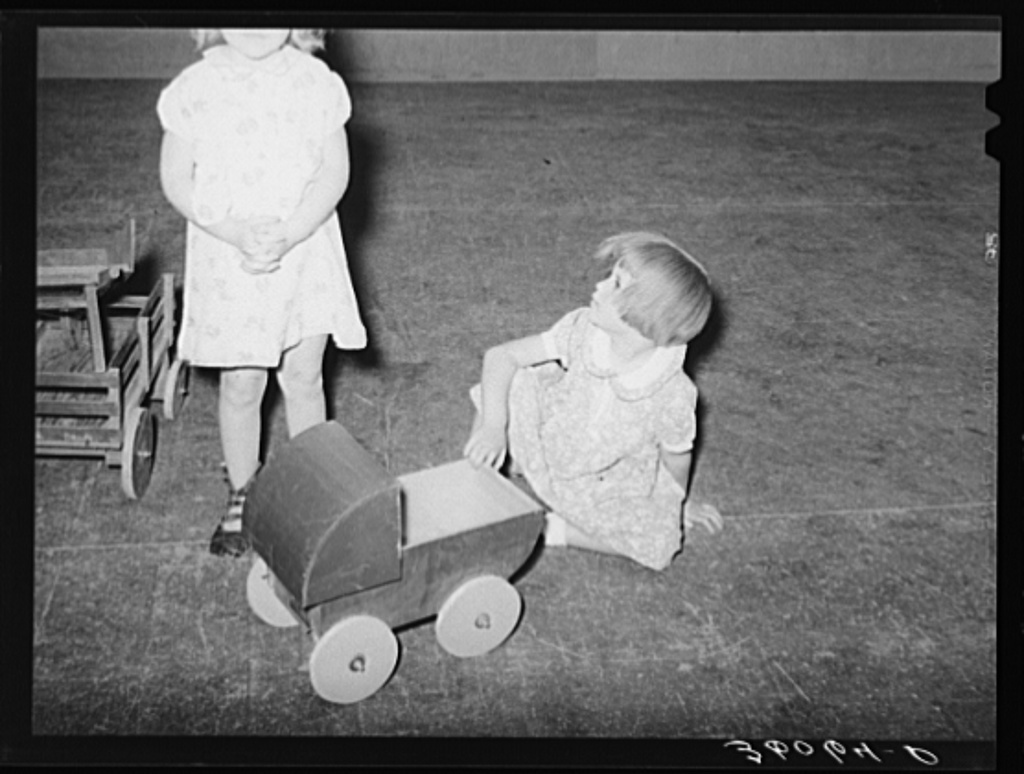 Child of agricultural worker playing in the WPA (Work Projects Administration) nursery school at the Agua Fria migratory labor camp. Arizona