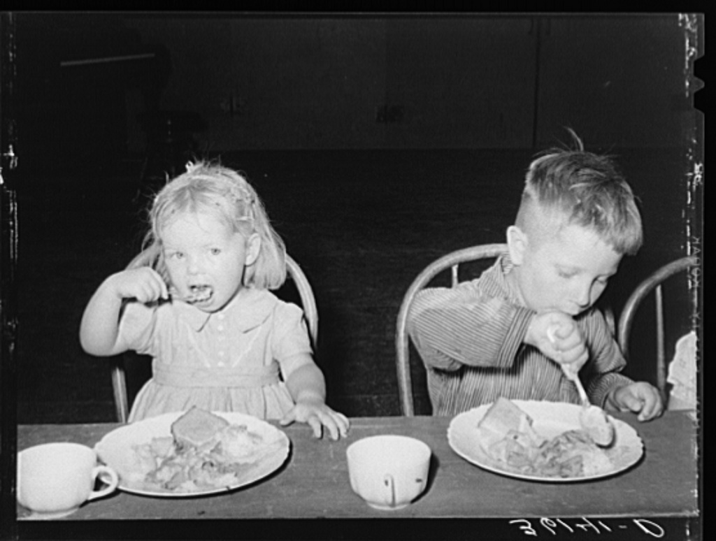 Children eating lunch at WPA (Work Projects Administration) nursery school at the Agua Fria migratory labor camp. Arizona