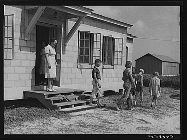 Children leaving health clinic after getting typhoid antitoxin shots at Osceola migratory labor camp. Belle Glade, Florida