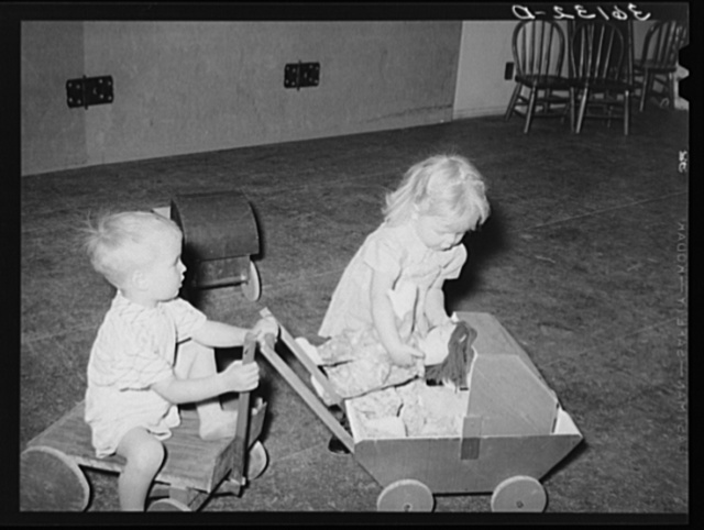 Children of agricultural laborers playing at the WPA (Work Projects Administration) nursery school at the Agua Fria migratory labor camp. Arizona