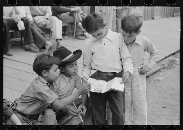 Children of gold miners looking at the comics, Mogollon, New Mexico