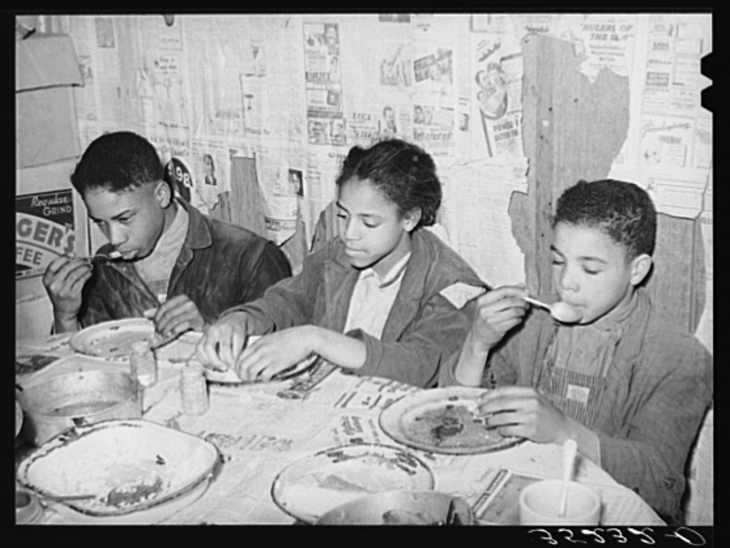 Children of Pomp Hall, Negro tenant farmer, eating their supper. For supper the family had corn bread, peas, gravy, rice, fried bacon and turnips. See general caption number 23. Creek County, Oklahoma