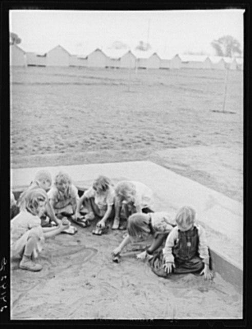 Children playing in sandbox. Tulare migrant camp. Visalia, California