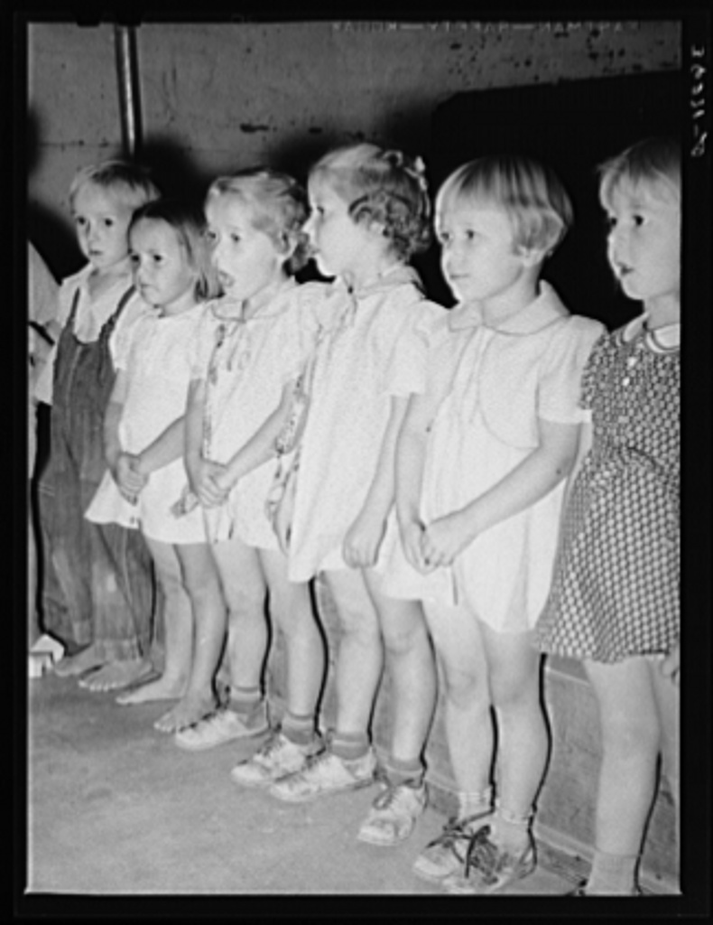 Children singing at the nursery school of the Casa Grande Valley Farms. Pinal County, Arizona