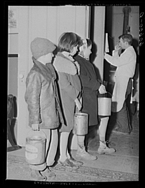 Children waiting in line for soup given out each night by the city mission, a community chest- financed organization. Dubuque, Iowa