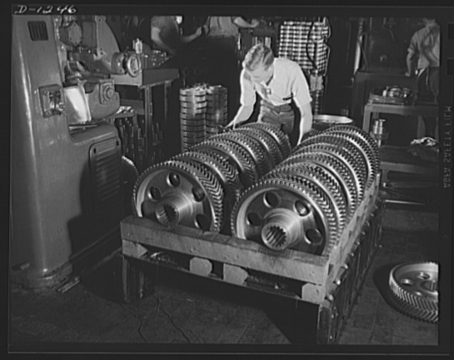 Chrysler tank arsenal. Headed for the oven, this rack of herringbone gears has been completed and is now awaiting the hear treatment which will harden the gears for use in the M-3 tank. Dozens of different types of gear arrangements are used in these twenty-eight ton monsters