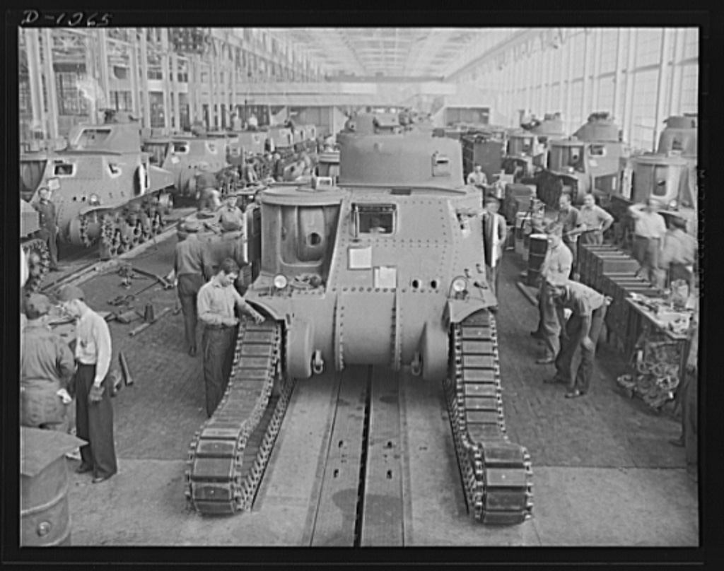 Chrysler tank arsenal. Workers in the huge tank Chrysler arsenal near Detroit, putting the tracks on one of the giant M-3 tanks. These rolling arsenals weigh twenty-eight tons, are capable of speeds over twenty-five miles an hour and are equipped with 75 mm. field artillery gun and a 37 mm. anti-aircraft gun, as well as four mounted machine guns and various unmounted arms its crew may carry. The tanks are powered by 400 horsepower Wright Whirlwind aviation engines