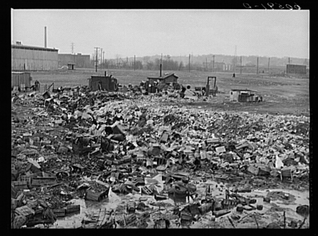 City dump. Dubuque, Iowa. In the background are shacks occupied by men who salvage anything marketable they can find in the dump