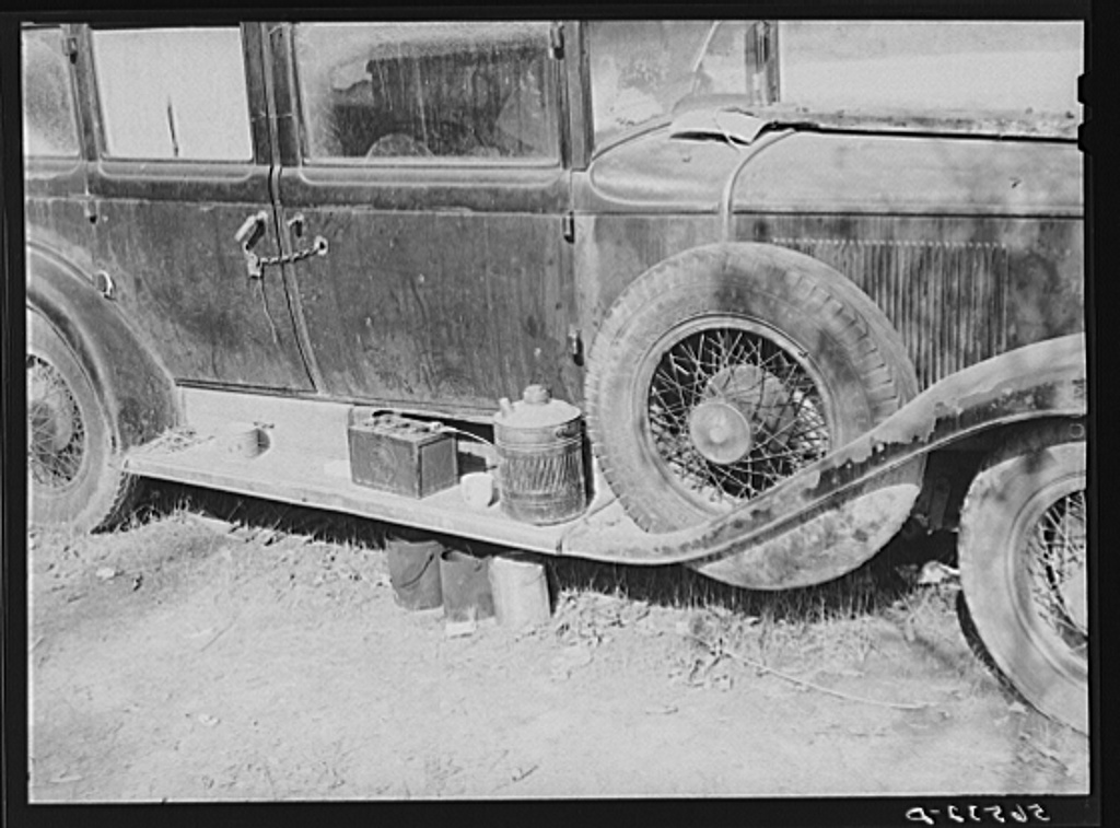 Close-up of car from Mississippi used for sleeping as well as shelter and traveling. Evidences of cooking outside are beside it. On highway near Camp Livingston. Alexandria, Louisiana