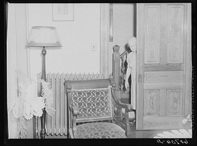 Closing sliding door to parlor. Home in Scranton, Iowa