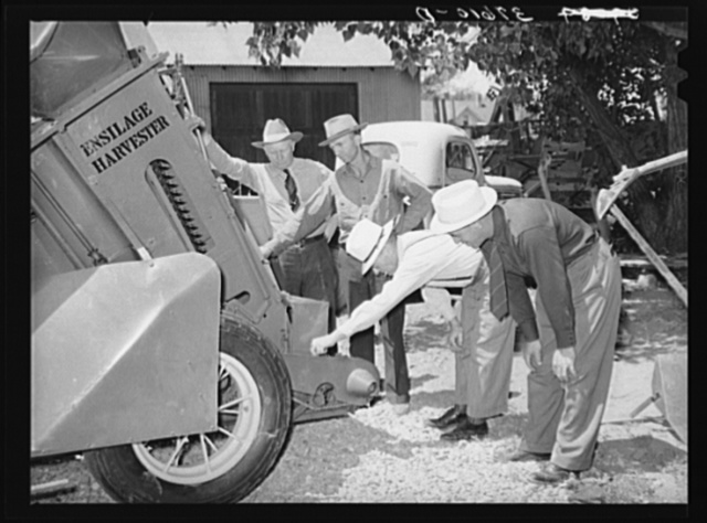 Committee of Cornish, Utah,  corn machinery cooperative looking over ensilage harvester. Preston, Idaho
