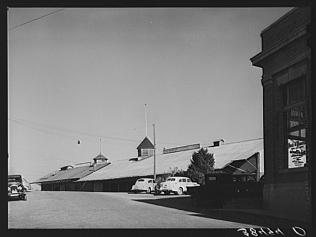 Corner of Bank of America and packing sheds of the Earl Fruit Company. New Castle, California