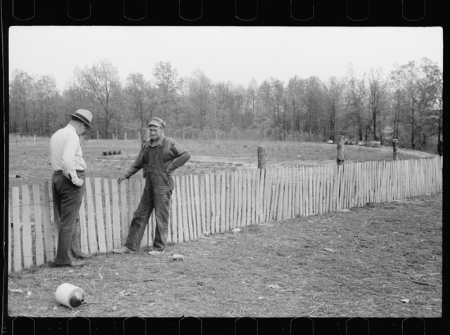 County supervisor visiting FSA (Farm Security Administration) borrower who is building a picket fence around his place, Grant County, Illinois