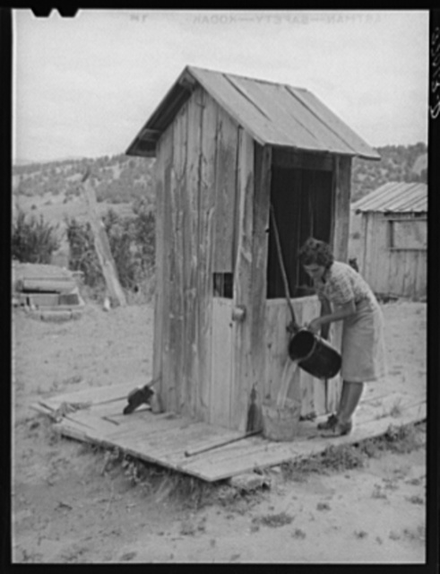 Covered well on Spanish-American family. Chamisal, New Mexico