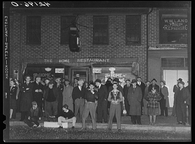 "Crowds gathered around the ""Norwich Express"" newspaper office listening to the election returns. Norwich, Connecticut"