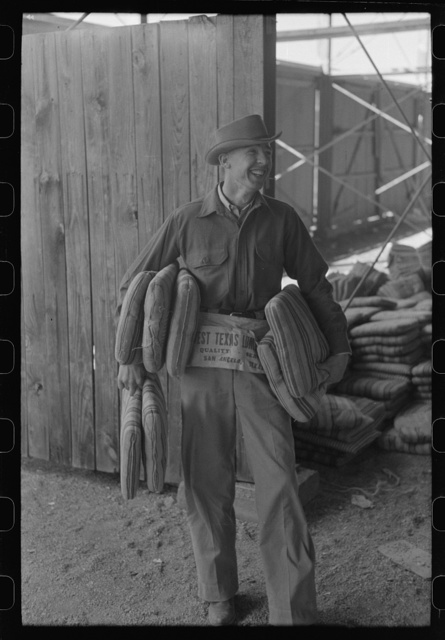Cushion seller at the rodeo during the San Angelo Fat Stock Show, San Angelo, Texas