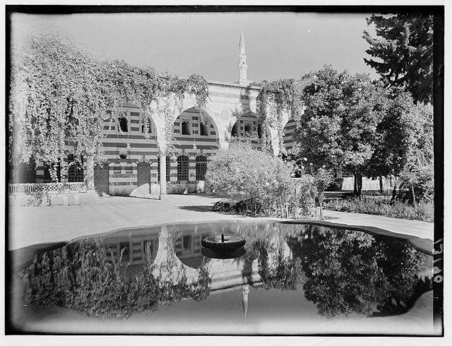 Damascus, Palais Azem. Courtyard & colonnade. Colonnade reflected in water