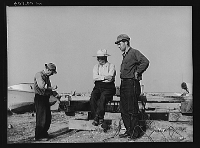 Deal Island fisherman. Man on left is opening an oyster. Eastern Shore, Maryland