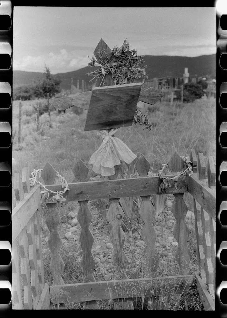 Decoration of grave in Spanish-American cemetery, Penasco, New Mexico