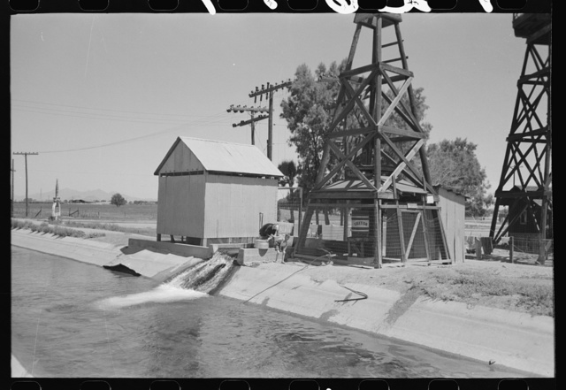 Deep water well that flows into the irrigation ditch. Irrigation is necessary for the raising of all crops in this section, Maricopa County, Arizona