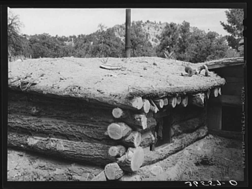 Detail of dugout. Pie Town, New Mexico. Notice that the roof is dirt over pinon poles