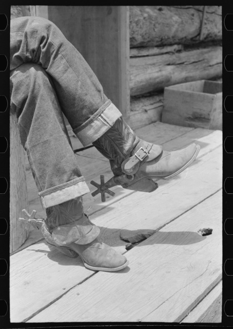 Detail of farmer's blue jeans, boots and spurs. This man was once a cowboy and still prefers the cowboy's dress. Pie Town, New Mexico