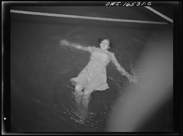 Detroit, Michigan. A Venetian night part at the Detroit yacht club, whose members represent the wealthier class of manufacturers and their friends. Girl with clothing swimming