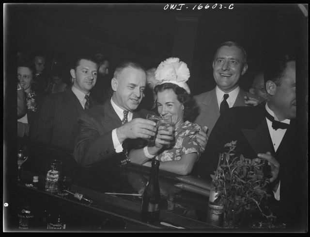 Detroit, Michigan. A Venetian night party at the Detroit yacht club, whose members represent the wealthier class of manufacturers and their friends. Couple drinking at the bar