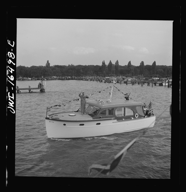 Detroit, Michigan. A Venetian night party at the Detroit yacht club, whose members represent the wealthier class of manufacturers and their friends. Small cabin cruiser