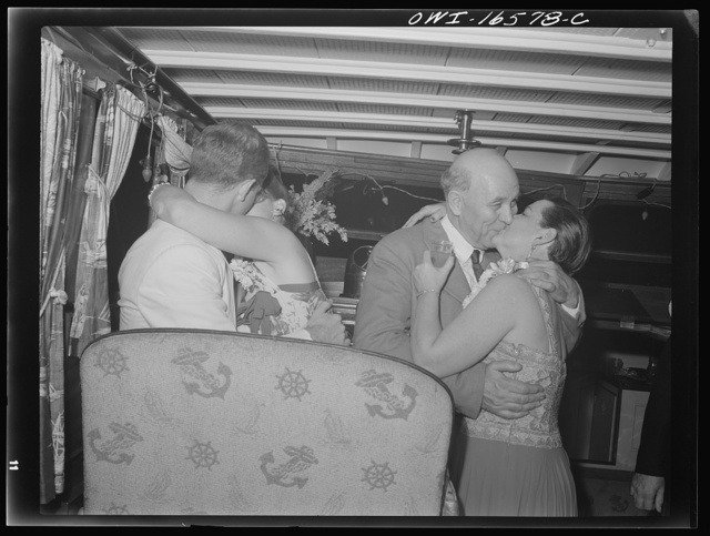 Detroit, Michigan. A Venetian night party at the Detroit yacht club, whose members represent the wealthier class of manufacturers and their friends. Couple kissing in a boat