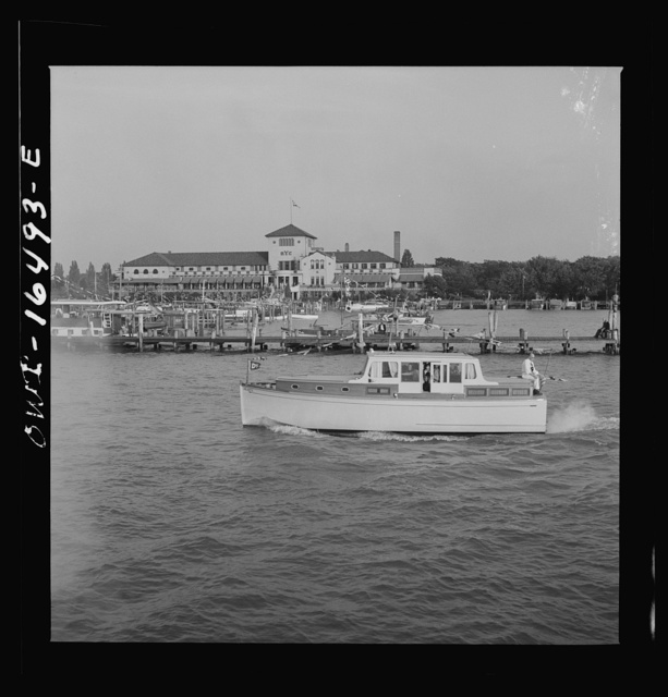 Detroit, Michigan. A Venetian night party at the Detroit yacht club, whose members represent the wealthier class of manufacturers and their friends. Motorboat