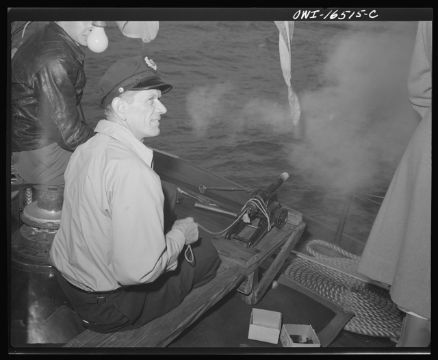 Detroit, Michigan. A Venetian night party at the Detroit yacht club, whose members represent the wealthier class of manufacturers and friends. Sailor with a small cannon used to salute boats