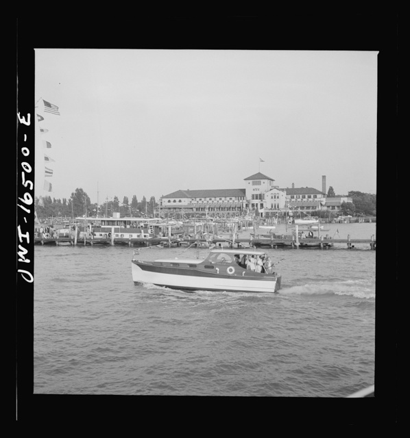 Detroit, Michigan. A Venetian night party at the Detroit yacht club, whose members represent the wealthier class of manufacturers and their friends. Small cabin crusier