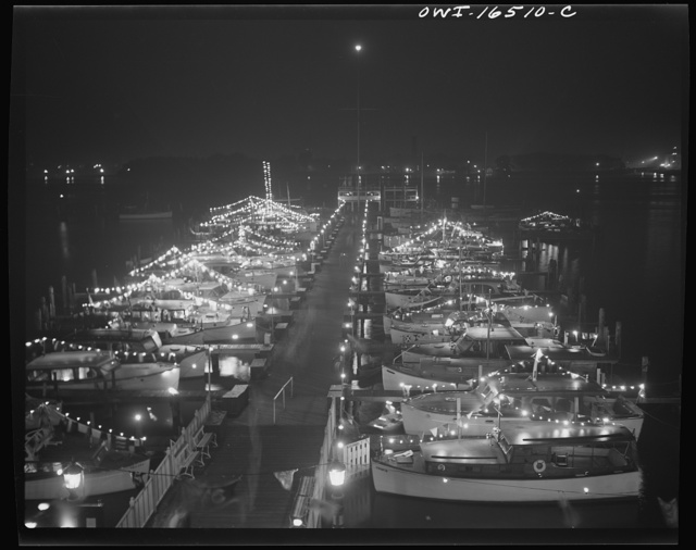 Detroit, Michigan. A Venetian night party at the Detroit yacht club, whose members represent the wealthier class of manufacturers and their friends. Cabin cruisers and sailboats decorated with lights