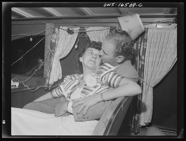 Detroit, Michigan. A Venetian night party at the Detroit yacht club, whose members represent the wealthier class of manufacturers and their friends. Chummy couple in a boat