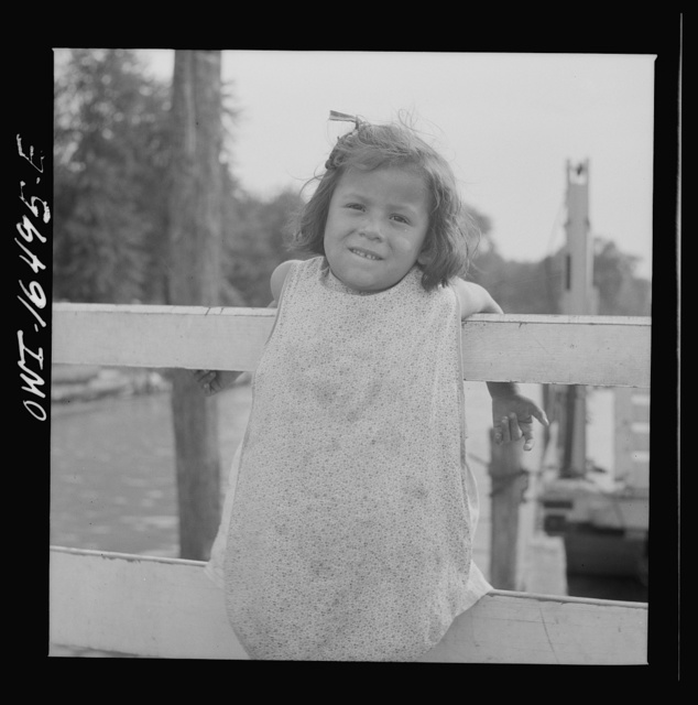 Detroit, Michigan. A Venetian night party at the Detroit yacht club, whose members represent the wealthier class of manufacturers and their friends. Little girl at the entrance to the yacht club