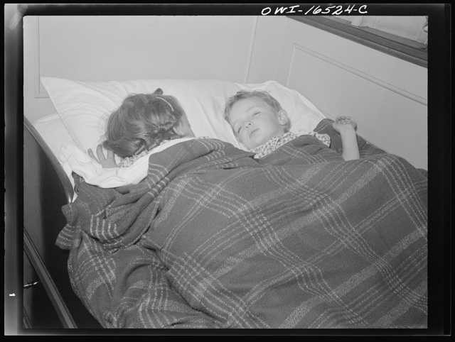 Detroit, Michigan. A Venetian night party at the Detroit yacht club, whose members represent the wealthier class of manufacturers and their friends. Children sleeping