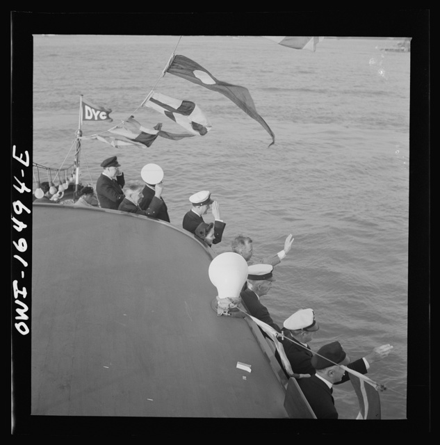 Detroit, Michigan. A Venetian night party at the Detroit yacht club, whose members represent the wealthier class of manufacturers and their friends. Yachtsmen reviewing the fleet