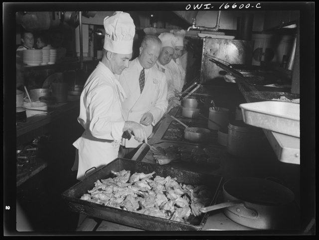 Detroit, Michigan. A Venetian night party at the Detroit yacht club, whose members represent the wealthier class of manufacturers and their friends. Frying chicken