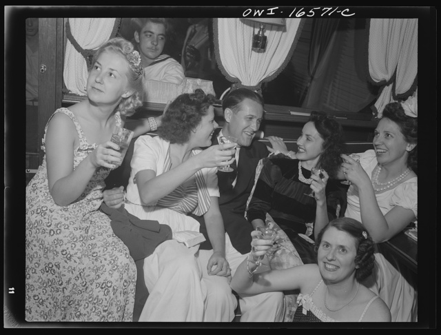 Detroit, Michigan. A Venetian night party at the Detroit yacht club, whose members represent the wealthier class of manufacturers and their friends. Commodore and girls drinking