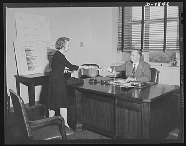 Donald M. Nelson. With Mr. Nelson in photo is his secretary, Miss Iona Thornton