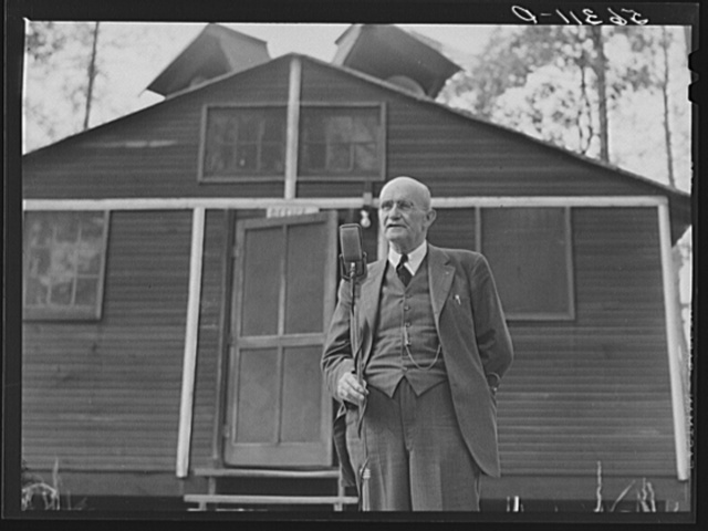 Dr. Mallory speaking at a picnic and barbecue at the CCC (Civilian Conservation Corps) camp following a meeting of the county land use planning committee in the courthouse in Yanceyville. Caswell County, North Carolina